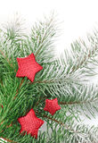 Christmas firtree with red stars and white snow Royalty Free Stock Photography