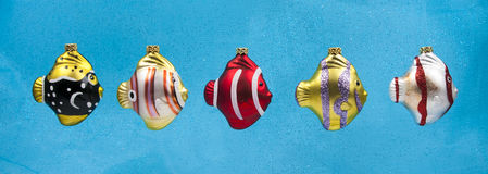 Christmas fish ornaments on blue background Royalty Free Stock Image