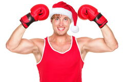 Christmas fitness boxer wearing santa hat. Smiling happy. Funny portrait of fit exercise model isolated on white background Royalty Free Stock Photos