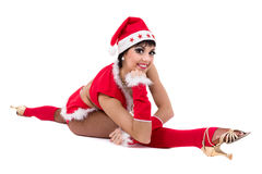 Christmas fitness woman doing the splits wearing santa, isolated on white background. Stock Photography