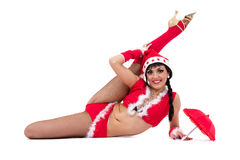 Christmas fitness woman doing the splits wearing santa, isolated on white background. Royalty Free Stock Photos
