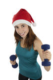 Christmas fitness woman with dumbbells. Young fit christmas woman holding dumbbells Royalty Free Stock Image