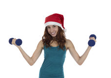 Christmas fitness woman lifting weights Royalty Free Stock Photo