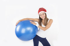 Christmas fitness woman in santa hat Stock Photography