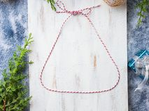 Christmas flat lay background with twine bell. Frame on white wooden board Stock Photo