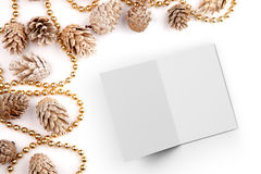 Christmas flat lay mockup desktop image with pine cones and open card Royalty Free Stock Photo