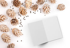 Christmas flat lay mockup desktop image with pine cones and open card Royalty Free Stock Photos