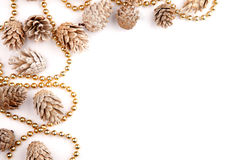Christmas flat lay mockup desktop, pine cones & gold beads on a white background Royalty Free Stock Photo