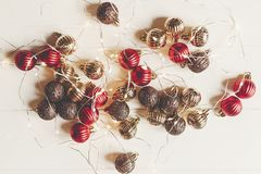 Christmas flat lay. red and gold christmas ornaments and lights Royalty Free Stock Photos