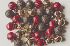 Christmas flat lay. red and gold christmas ornaments on white wo Royalty Free Stock Photos