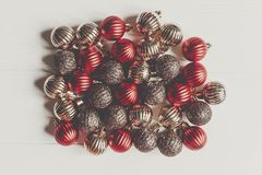 Christmas flat lay. red and gold christmas ornaments on white wo Stock Images