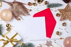 Christmas flat lay scene with golden decorations stock images