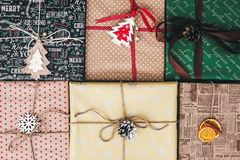 Christmas flat lay. stylish wrapped gift boxes top view, with or stock image