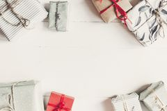 Christmas flat lay. wrapped present boxes on white wooden backgr. Ound top view, space for text.  seasonal greetings card. happy holidays. merry christmas Royalty Free Stock Photos