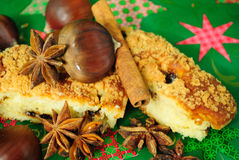 Christmas flavor. Chestnuts, cinnamon sticks, star anise, and a perfect cake for Christmas Royalty Free Stock Photography