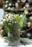 Christmas Floral2. Christmas floral arrangement with white, green, and frosted etched glass vase Royalty Free Stock Photo