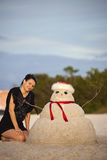 Christmas in Florida. Girl and sandman on the beach Royalty Free Stock Photo