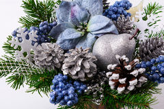 Christmas flower arrangement with blue silk poinsettias Stock Photo