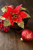 Christmas flower and balls on plywood Royalty Free Stock Images