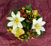 Christmas flower decoration. Christmas flower  decoration on a red crushed tissue background Royalty Free Stock Photos