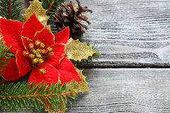Christmas flower red with bows on a wooden board Stock Photo