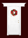 Christmas flower wreath on white door Royalty Free Stock Photos