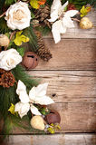 Christmas flowers and pine branches on wood. En background royalty free stock images