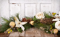 Christmas flowers and pine branches on wood. En background royalty free stock photos