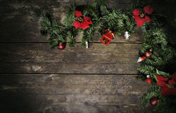 Christmas flowers and pine on weathered wood stock photos
