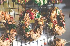 Christmas flowers wreaths decorations in Cracow Christmas market. In Poland Royalty Free Stock Image