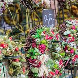 Christmas flowers wreaths decorations in Cracow Christmas market. In Poland Stock Photography