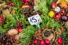 Christmas flowers wreaths decorations in Cracow Christmas market. In Poland Stock Photo