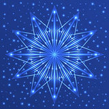 Christmas fluorescent snowflake on blue background with sparkles Stock Photos
