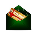 Christmas fly air ticket in green envelope isolated over white. Background Stock Photography