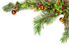 Christmas foliage frame corner. Holiday garland with ornaments, pine branches, pine cones and evergreen with berries (Common Bearberry/Kinnikinnick royalty free stock photography