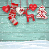 Christmas folklore decorations hanging in front of blue wooden wall, illustration Royalty Free Stock Images