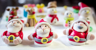 Christmas fondant cake. Santa claus doll that making from fondant sugar stock photos
