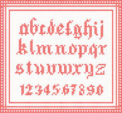Christmas Font: knitted gothic alphabet in red color. Stock Photos