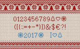 Christmas font. Knitted latin alphabet on seamless knitted pattern with snowflakes and fir. Nordic fair isle knitting, winter holi. Day sweater design. Vector Royalty Free Stock Photography