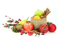 Christmas Food. Winter fruits and nuts on white background Royalty Free Stock Photos
