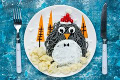 Christmas food art penguin healthy lunch for kids. Top view Stock Photography