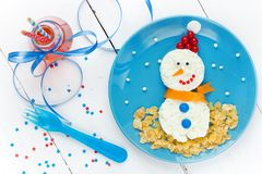 Christmas food art snowman healthy breakfast for kids. Top view royalty free stock image