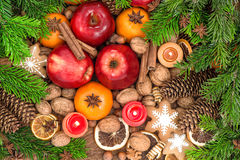 Christmas food backdround. Fruits, cookies, spices and nuts Royalty Free Stock Photos