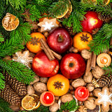 Christmas food backdround. Fruits, nuts, spices and cookies Royalty Free Stock Photo