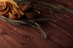 Christmas food background - mulled wine. Decorative border of spices on dark brown wooden board. Royalty Free Stock Photography
