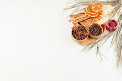 Christmas food background - mulled wine. Decorative border of spices and drinks on white wood board. stock image