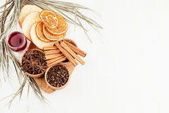 Christmas food background - mulled wine. Decorative border of spices and drinks on white wood board. Stock Photography