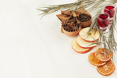 Christmas food background - mulled wine. Decorative border of spices and drinks on white wood board. Top view. Royalty Free Stock Photography