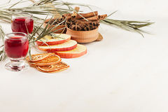 Christmas food background - mulled wine. Decorative decoration of spices and drinks on white wooden table. Royalty Free Stock Photography