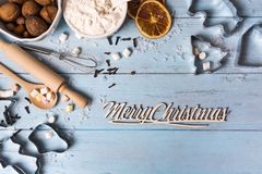 Christmas food background. Christmas background : tools for dough, flour, spices and nuts for making Christmas cookies, food frame, copy space flat lay royalty free stock image